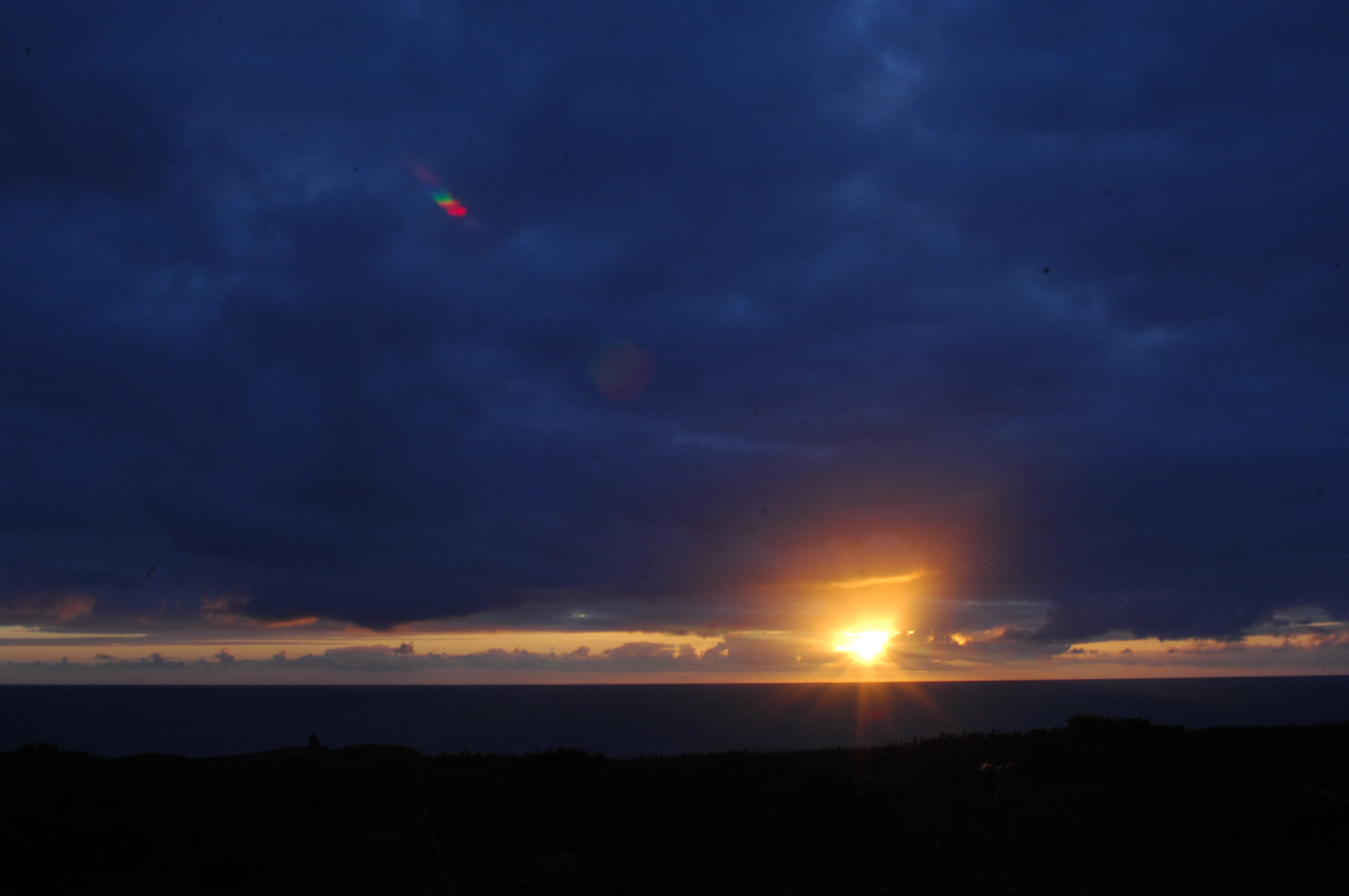 Sunset over the ocean at Widemouth Bay