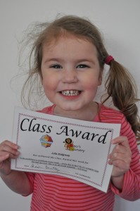 Day 15: Lola being so happy to have received her first certificate from school #proud