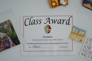 Day 415:  Ella was awarded the Class Award this week and received a certificate and trophy for her literacy work