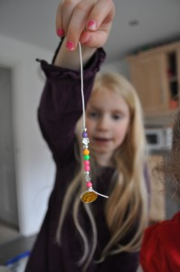 Day 48:  Making bracelets with the girls on a rainy afternoon