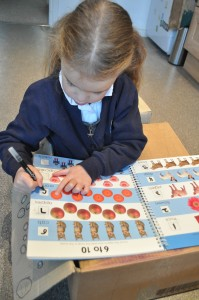 Day 250:  Lola practising writing her numbers and being so proud of herself when she got them all right