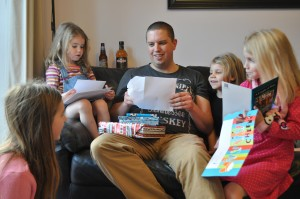Day 290:  My husband's birthday - here he is surrounded by all his girls and being spoiled with presents