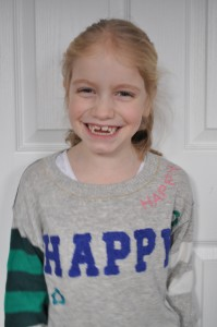 Day 311:  My girl wearing her new favourite 'Happy' jumper.  This smile was pretty much the only one she gave all day, but even one minute of sunshine is better than none.