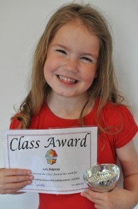 Day 436:  Lola came home from school with the Class Award trophy and certificate for her reading.  She was so proud!