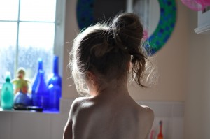 Day 457:  Capturing this shot of my littlest daughter, lost in thought as she washed her hands.