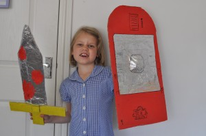 Day 474:  Ella with her home-made Roman sword and shield for a school project.  I only helped her with a couple of bits (double-sided tape can be really tricky for little fingers!) and she's really proud of all her hard work.