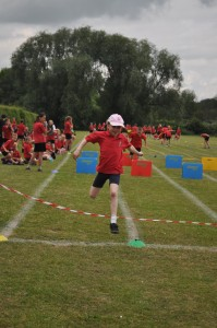 Day 477:  Sports Day.  Ella didn't participate last year - she flat out refused.  This year she has been super-excited about it for weeks, and actually won two of her races!  All three girls tried their best, cheered on their teammates and really enjoyed themselves.