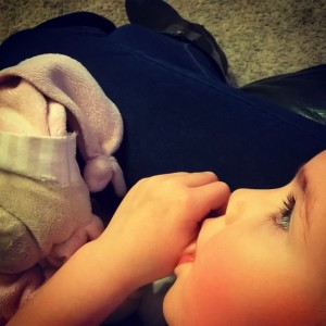Day 318:  Her thumb, her Teddy and snuggling on my lap = happiness