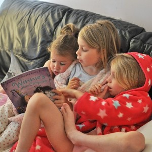 Day 512:  I popped to Tesco at 7am and left one husband and three girls sleeping.  When I returned half an hour later, I found Ella reading a story to her younger sisters (while my husband was still fast asleep upstairs!)