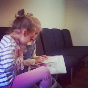 Day 237:  The girls love our twice-yearly trip to the dentist (mainly because they get stickers!).  Here are Mimi and Lola in the waiting room practising their reading.